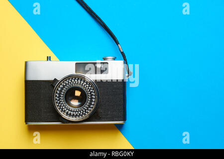 Flat lay vintage camera on colorful background with copy space. - Stock Photo