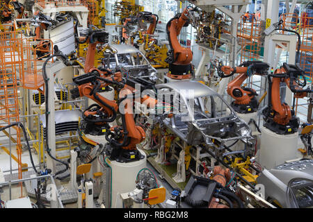 body of car on conveyor top view. Modern Assembly of cars at the plant. The automated build process of the car body - Stock Photo