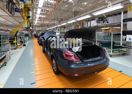 Assembled car is on the Assembly line. Robotic equipment makes the Assembly of the car. Modern car Assembly at the factory - Stock Photo