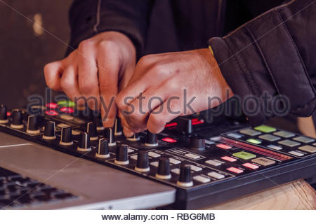 Sound engineer hands working on sound mixer - Stock Photo