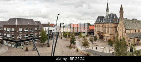 Bishop Auckland, County Durham, UK. The market place, with the Victorian Gothic town hall containing the library and a theatre - Stock Photo