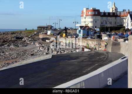 The town of Porthcawl with its new sea defences being built for protection against the Atlantic sea waves battering the towns defences. - Stock Photo