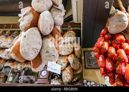 Bologna, Italy - June 2017: Local shop with traditional prosciutto and salami in Bologna. Emilia Romagna. - Stock Photo