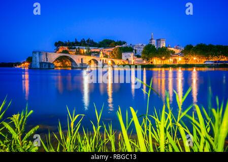 Avignon Bridge with Popes Palace and Rhone River at sunrise, Pont Saint-Benezet, Provence, France. - Stock Photo