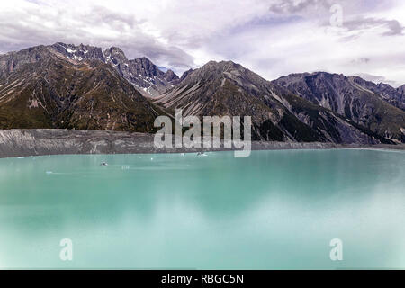 Beautiful turqouise Tasman Glacier Lake and Rocky Mountains of the Mount Cook National Park, South Island, New Zealand - Stock Photo