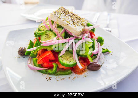 Greek salad with fresh vegetables, feta cheese and olives, Greece traditional cuisine. - Stock Photo