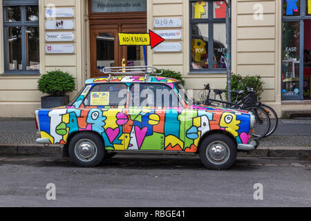 Berlin, Germany, Europe : June 2016  : An old colourful classic Trabant car for hire - Stock Photo