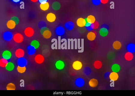 Blured color lights on dark background - Stock Photo