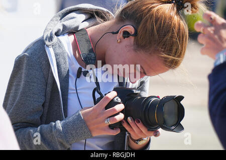Unfamiliar girl with a camera - Stock Photo