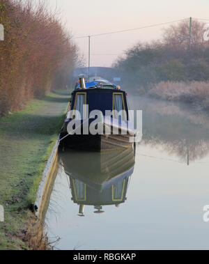early morning canal boats on the oxford canal at napton on the hill in oxfordshire - Stock Photo