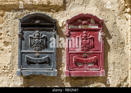 Typical old Italian letter boxes in black and magenta. - Stock Photo
