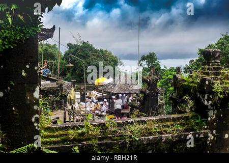Bali, Indonesia - 08 March 2018: People preparing to celebrate in balinese temple. Pura Penataran Agung Lempuyang and Balinese Hindu ethnic people - Stock Photo