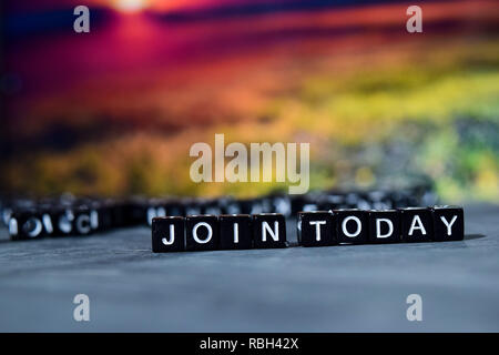 Join today on wooden blocks. Cross processed image with bokeh background - Stock Photo
