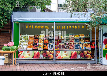 August 26, 2012. Piran, Slovenia. Farm fruit shop on the street of the city on a Sunny summer day. Sold Pineapples, peaches, berries, melons - Stock Photo
