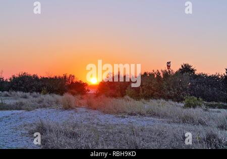 Beautiful sunset shot of the baltic sea beach in Laboe Germany - Stock Photo
