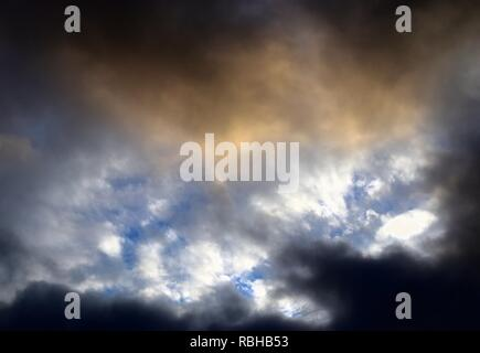 Dramatic and cloudy sky with some blue elements - Stock Photo