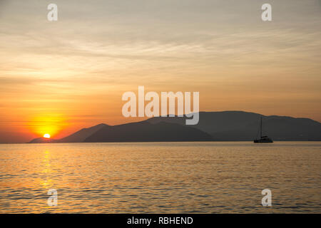 The sun rising over the island. Nha Trang, Vietnam - Stock Photo