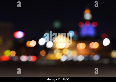 Blur lights cityscape in night for a background. Bokeh defocused night lights in a city, Warsaw. - Stock Photo