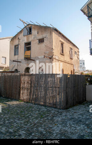 Ruined house, soon to be renovated in the American Colony, Tel Aviv, Israel - Stock Photo