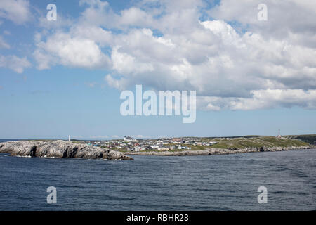 PORT AUX BASQUES, NEWFOUNDLAND, CANADA - August 19, 2018: The town of Port aux Basques seen from a departing ferry traveling to Nova Scotia. - Stock Photo