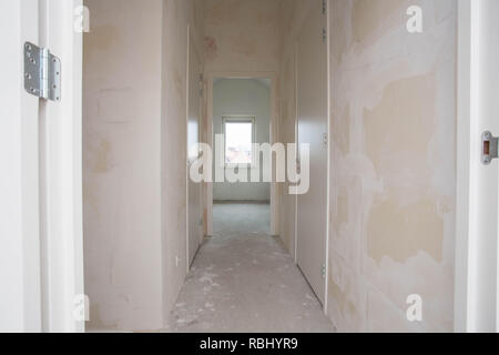 New construction property - Moving to new apartment - Door to modern living room - Stock Photo