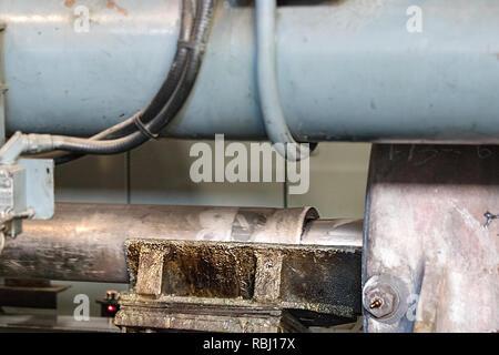 Detail of the short stroke of an aluminium extrusion press. - Stock Photo
