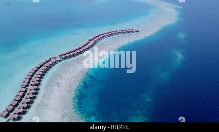 Beautiful aerial shot of row bungalows along ocean beach - Stock Photo