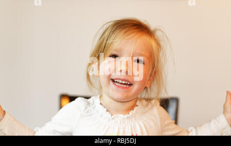 A portrait of a beautiful smiling four year old girl - Stock Photo