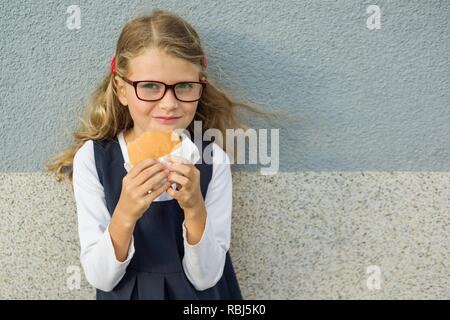 Happy school child with lunch. Back to school outdoor - Stock Photo