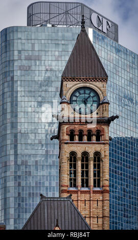 The Old City Hall in Toronto contrasts with the modern architecture that surrounds it - behind is the Cadillac Fairview building - Stock Photo