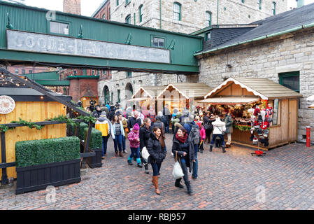 People walking in Toronto Christmas Market in The Distillery District - Stock Photo