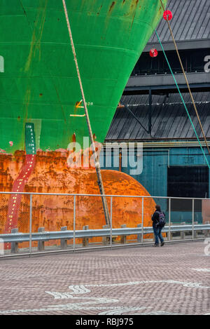 A photographer taking pictures of the bulk carrier ship Wigeon in Toronto Harbour, Canada - Stock Photo