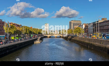 A view over the Liffey River from Ha'penny Bridge in Dublin, Ireland. - Stock Photo
