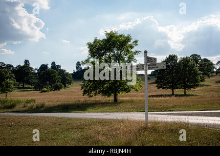 UK, Launde Abbey, Leicestershire - July 2018: Signpost points the directions and distances to several Leicestershire villages - Stock Photo