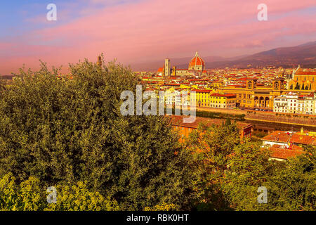 Colorful purple sunset city view with houses and Duomo dome, Florence, Italy - Stock Photo