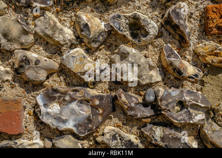 Close up background shot of an old flint wall commonly found in Sussex. - Stock Photo