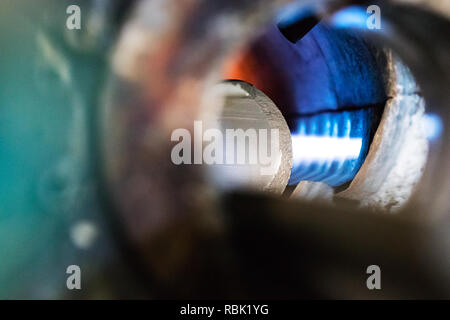 Detail of the entrance of a aluminium log furnace before the extrusion process - Stock Photo