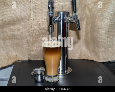Frothy, foamy Nitro cold brew coffee. - Stock Photo
