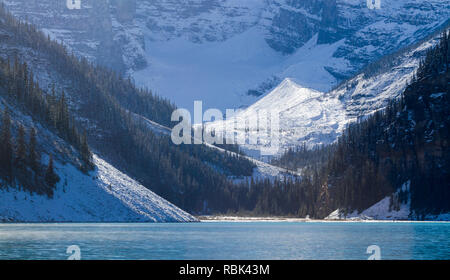 Spectacular glacial Lake Louise, in the shadow of Victoria Glacier, with snow on ground in fall in beautiful Banff National Park, Alberta, Canada.