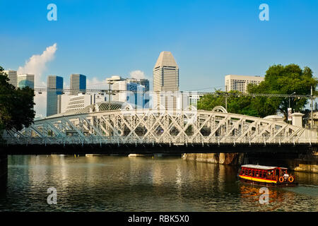 View over the Singapore River, Singapore, towards Anderson Bridge; seen from Cavenagh Bridge next to Fullerton Hotel - Stock Photo
