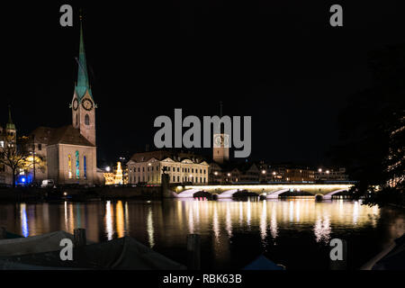 Zurich, ZH / Switzerland - January 4, 2019: night time city skyline view of Zurich with the river Limmat in winter - Stock Photo