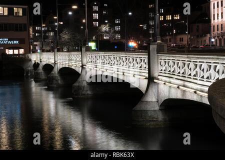 Zurich, ZH / Switzerland - January 4, 2019: nighttime view of the Rudolf-Brun bridge in downtown Zurich in winter - Stock Photo