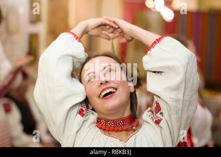 Belarus, Gomel, November 24, 2018. Reconstruction of an ethnic old Belarusian wedding.A woman is dancing in a Slavic national costume. Belarusian girl - Stock Photo
