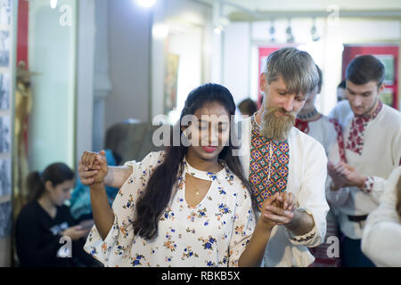 Belarus, Gomel, November 24, 2018. Reconstruction of an ethnic old Belarusian wedding.A man of Slavic appearance in embroidery is dancing with an Indi - Stock Photo