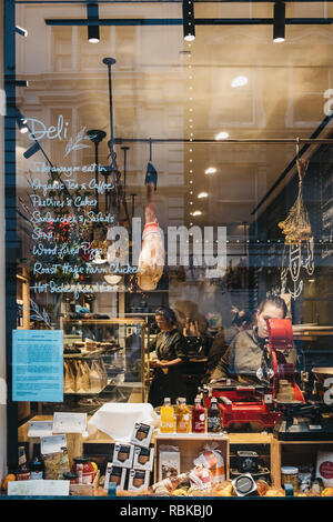 London, UK - January 5, 2019: People working inside Petersham Nurseries Deli in Covent Garden, view thought window. Covent Garden is a famous tourist  - Stock Photo