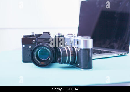 Computer keyboard, mouse and camera lie on table. - Stock Photo