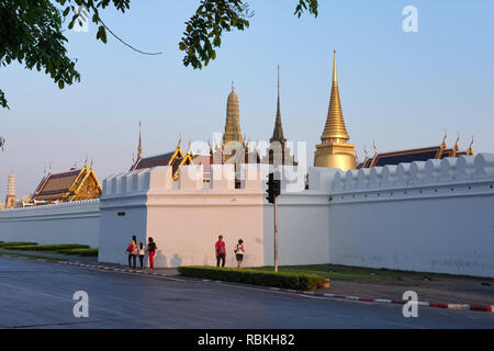 Wat Phra Kaew (Gaew) and Grand Palace in Bangkok, Thailand, home of the Jade Buddha and the country's most revered temple, seen from its northern wall - Stock Photo