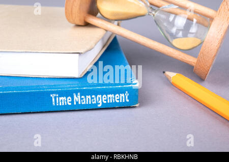 time management concept. blue book on a gray office table - Stock Photo