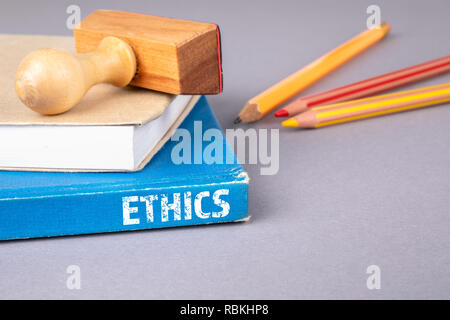 Ethics concept. blue book on a gray office table - Stock Photo