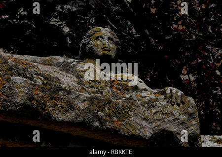 Tuscania, Lazio, Italy: lifelike stone effigy of ancient Etruscan citizen on sarcophagus lid, now re-used as distinctive urban furniture & public art. - Stock Photo